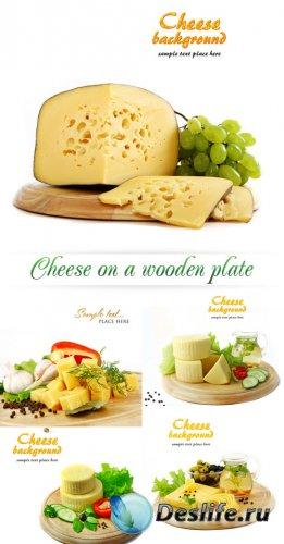Stock Photo: Cheese on a wooden plate | Сыр на деревянной досточке