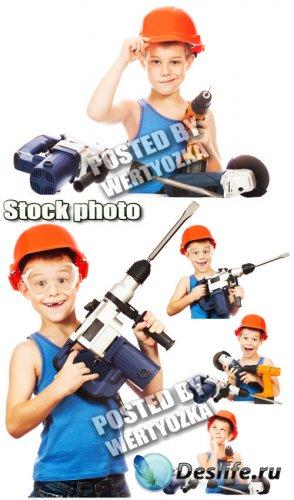 Строитель, мальчик с инструментами / Builder, a boy with tools - stock phot ...