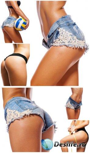 Девушка в джинсовых шортах / Girl in denim shorts - Stock photo