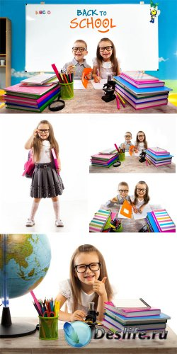 ���������, ������� � ������� �� ������ / School children, boy and girl at the desk - Stock Photo