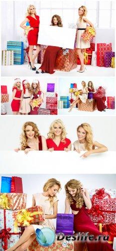 Beautiful girl and Christmas gifts - stock photos