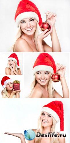 Beautiful blonde girl in santa hat - Christmas stock photos